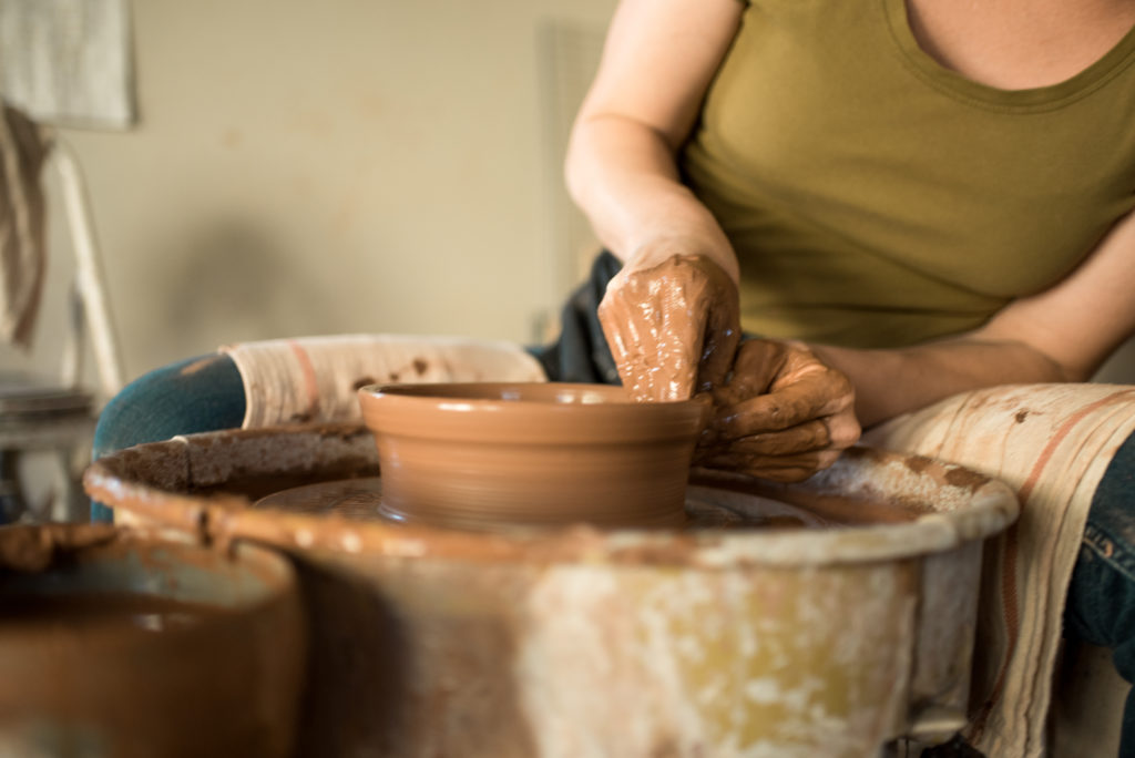 Christie Goodfellow of CGCERAMICS at the pottery wheel