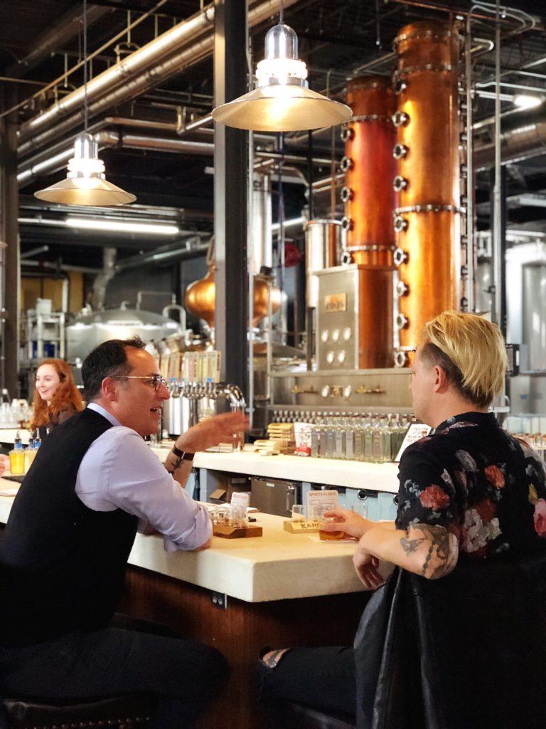 Host Brandon Dawson and Tattoo Artist Jermiah Griswold share a drink at Karrikin Spirits.