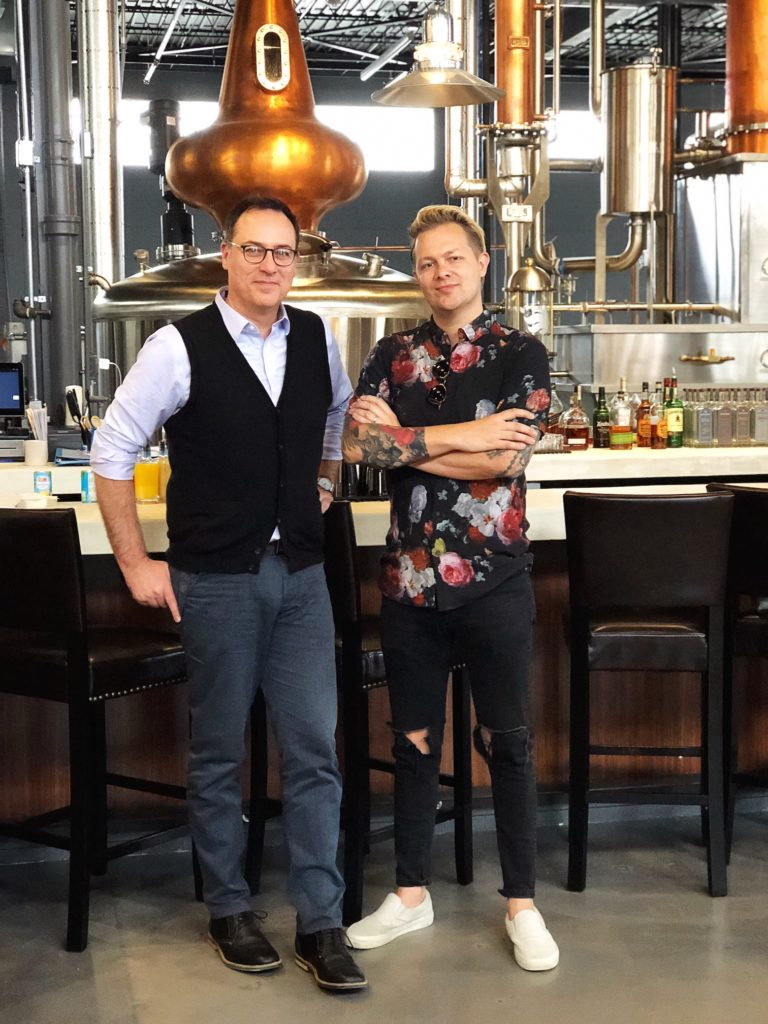 The Distiller host Brandon Dawson stands with Jeremiah Griswold at Karrikin Spirits.