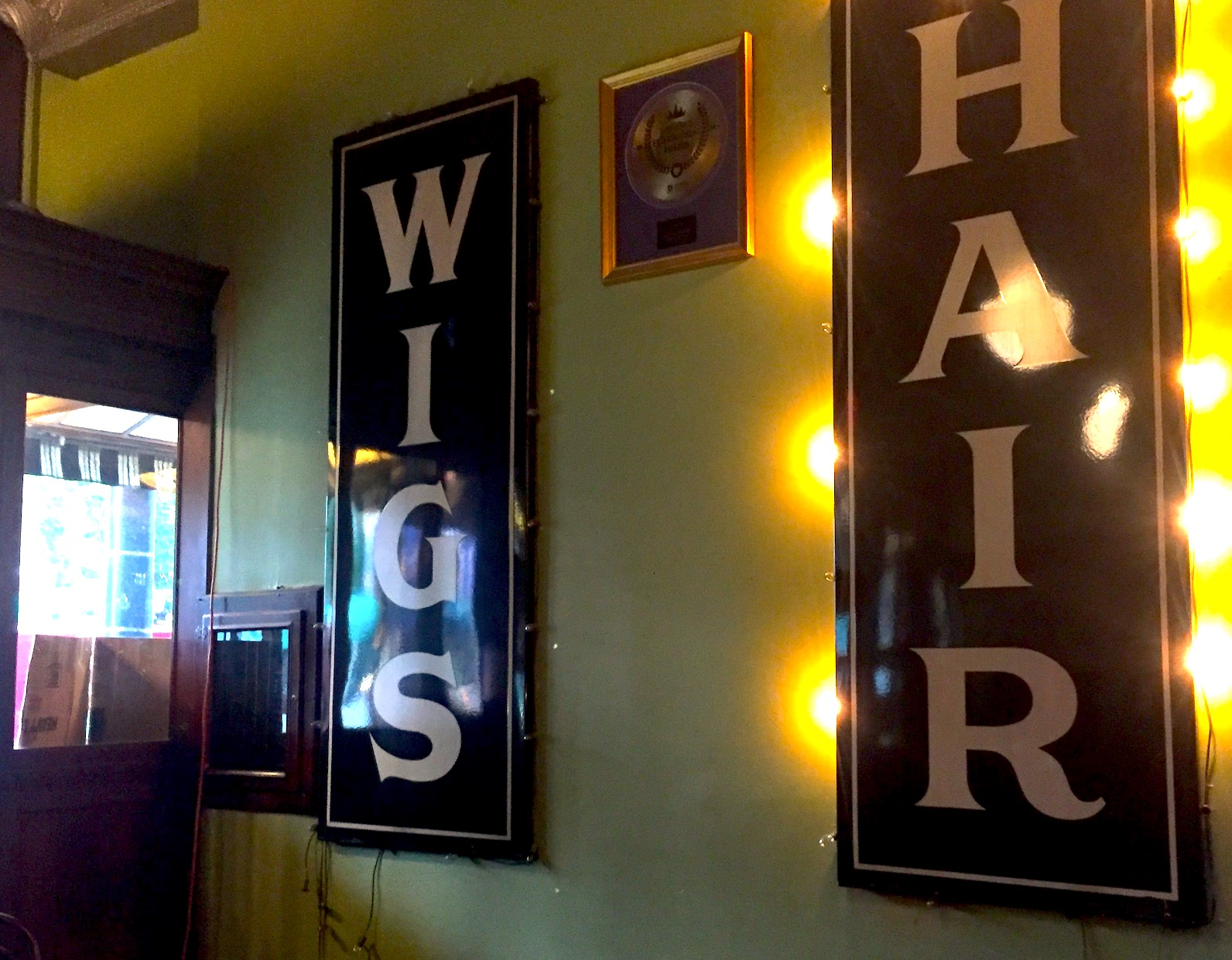Signs on the wall at Japp's Since 1879 say Wigs and Hair