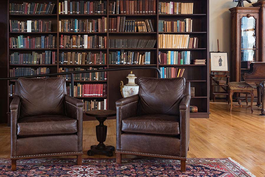 Two leather chairs in a reading area inside the Mercantile Library