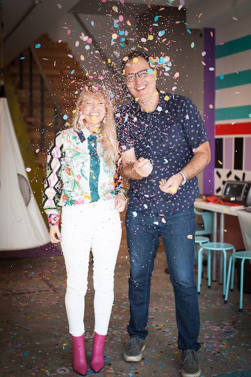 Allison Lester and Brandon Dawson throw confetti at the Digital Playscape