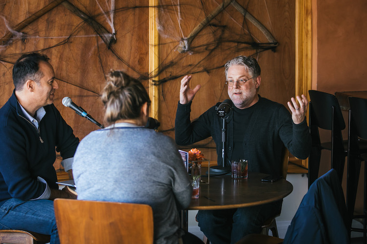 Flavorist Tony Moore gestures while talking with host Brandon Dawson on The Distiller podcast