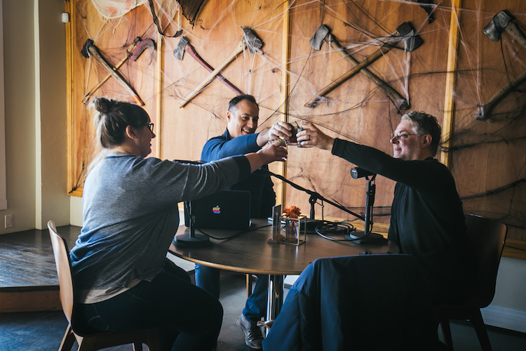 Distiller host Brandon Dawson toasts with flavorists Tony Moore and Lew Weeks