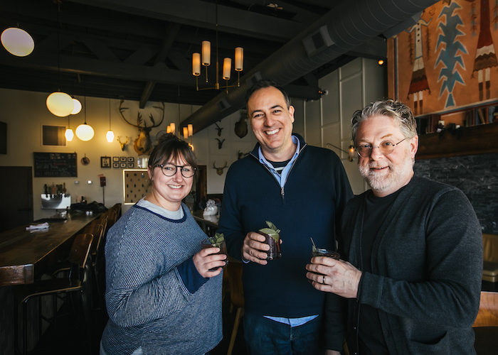 Host Brandon Dawson stands holiding a drink with flavorists Lew Weeks and Tony Moore