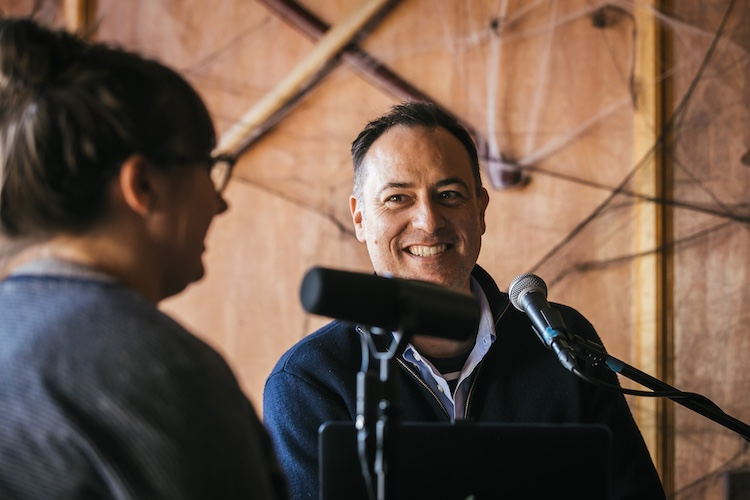 Host Brandon Dawson smiles while listening to flavor applications scientist Lew Weeks