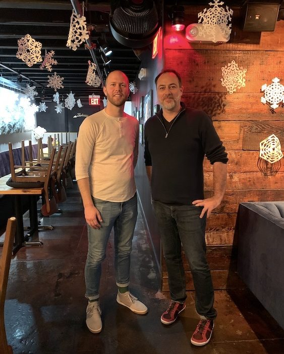 Image of Distiller host Brandon Dawson with psychologist Brandon Irvin at Kingfisher Bar in Durham NC