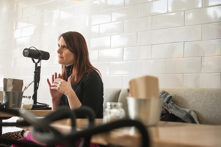 Former NASA Press Secretary Lauren Worley gestures while being interviewed on The Distiller podcast