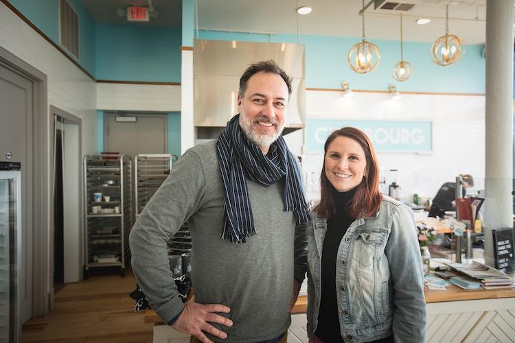 The Distiller podcast host Brandon Dawson stands with former NASA Press Secretary Lauren Worley at Cherbourg Bakery in Cincinnati