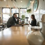 Host Brandon Dawson interviews former NASA press secretary Lauren Worley at Cherbourg Bakery in Cincinnati