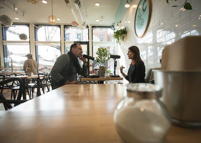 Host Brandon Dawson interviews former NASA press secretary Lauren Worley at Cherbourg Bakery in Cincinnati